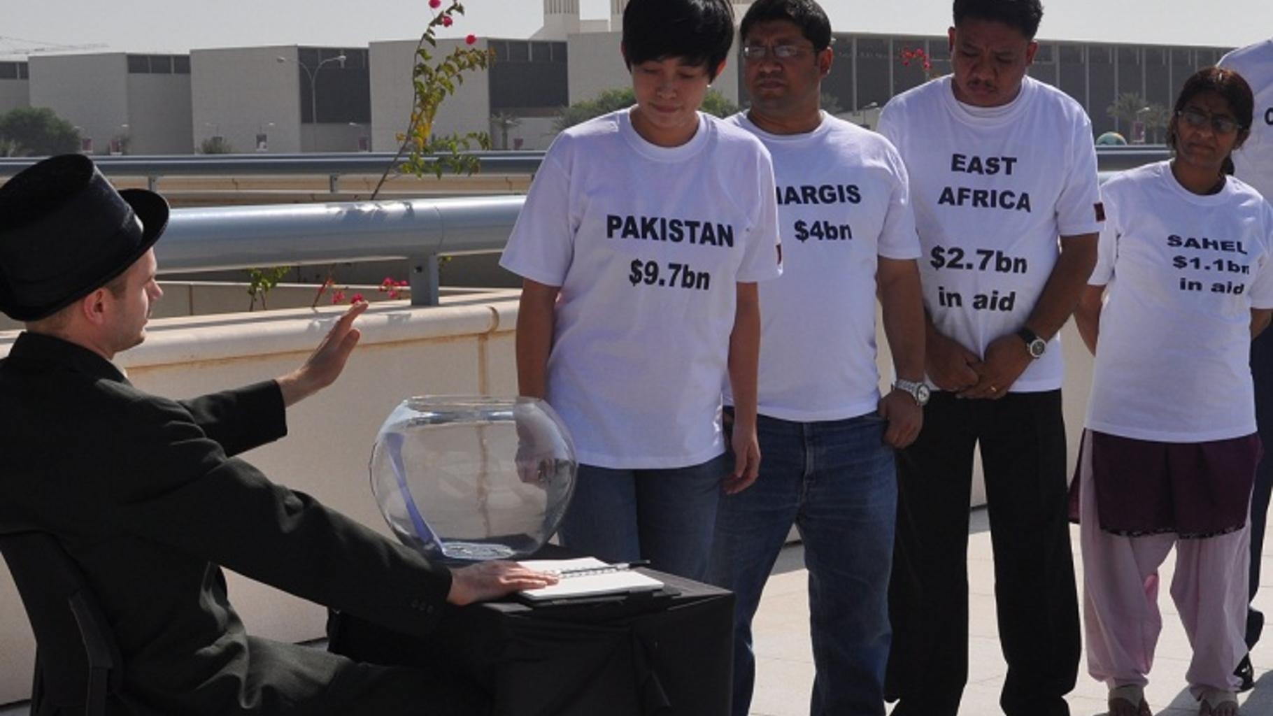 Foto: Oxfam-Aktion in Doha