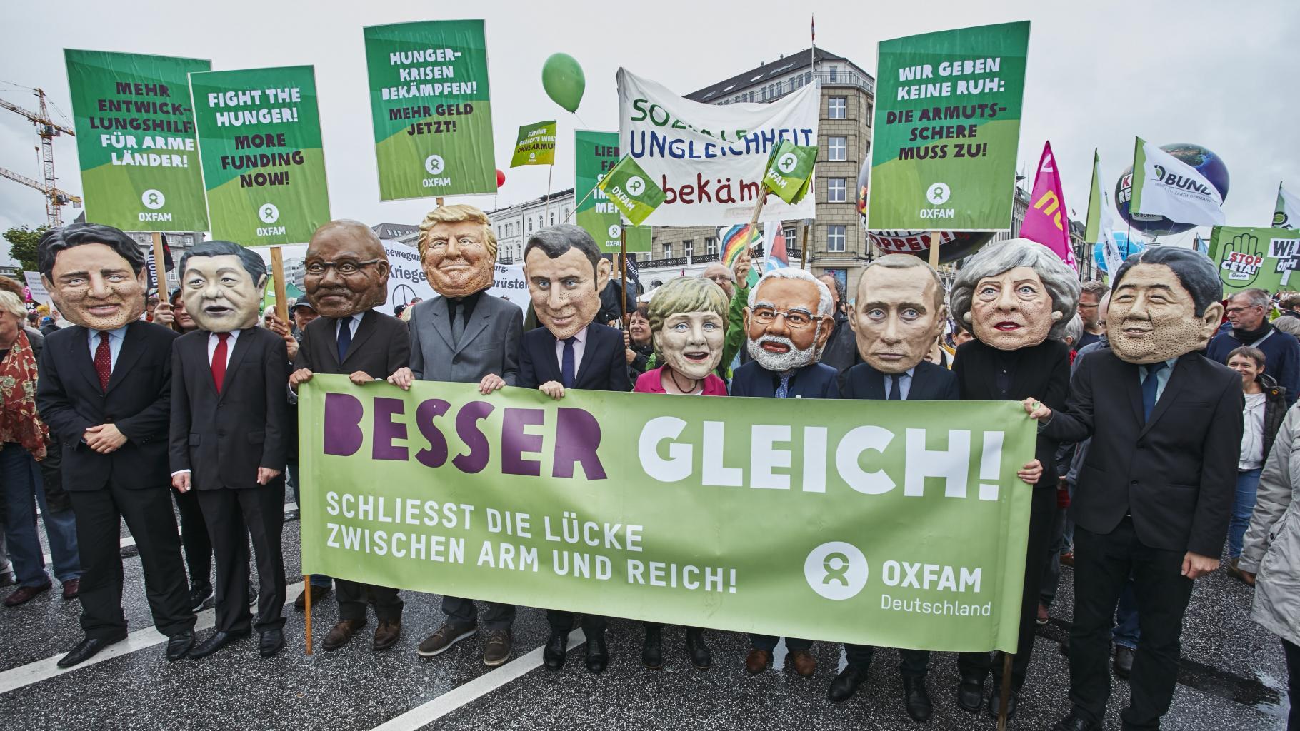 G20-Protestwelle mit Big Heads